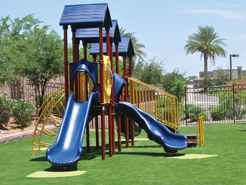 Playground Structure with Rubber patches at slide exits and Ameri-Grass protective safety surfacing
