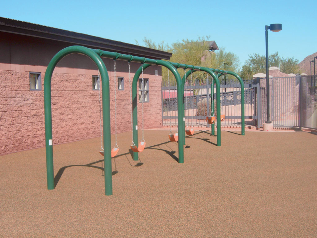 Arch Swings with poured-in-place rubber surfacing by ARS