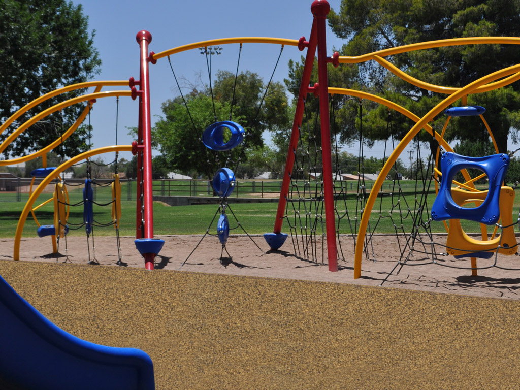 Activo Playground with poured-in-place rubber surfacing